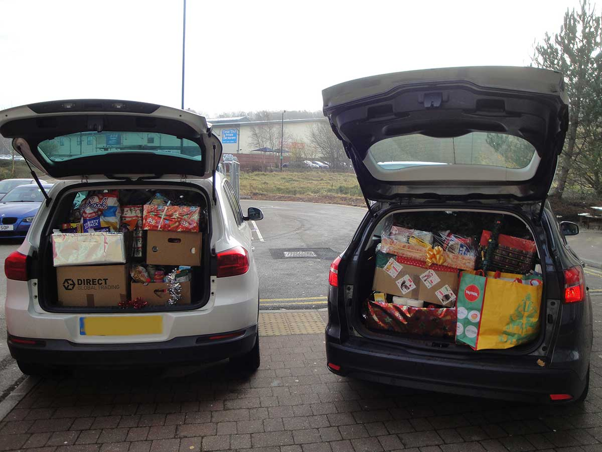 cars packed with charity foodbank boxes